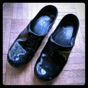 Dansko patent leather clogs